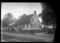 Brooklyn: [unidentified Dutch-style wooden farmhouse with manicured lawn and small trees], undated.