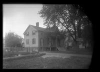 Brooklyn: [unidentified wooden house beside a church], undated.