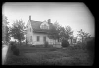 Brooklyn: [unidentified Dutch-style wooden farmhouse with manicured lawn and small trees, rear view], undated.