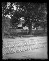 Brooklyn: [wooden barn and other outbuildings seen from street with trolley tracks], undated.