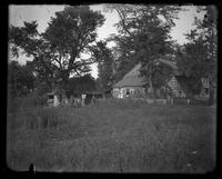 Brooklyn: [unidentified old wooden farmhouse and outbuildings backed by overgrown fields], undated.