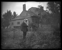 Brooklyn: old Dutch-style wooden house in overgrown field; older man in straw boater in foreground], undated.