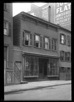 Brooklyn: [unidentified wooden building with ground-floor storefront], undated.