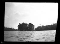 Westchester County: [view across an unidentified body of water to a small island, undated.]