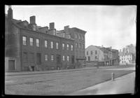 Manhattan / Brooklyn: [unidentified row houses on wide cobbled street, undated.]