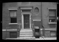 Manhattan / Brooklyn: [front entrance to unidentified townhouse converted to apartments, undated. Seven separate doorbell buttons visible.]