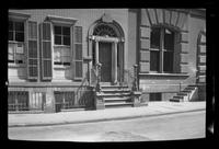 Manhattan / Brooklyn: [front door and stoop of unidentified brick townhouse, undated.]