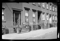 Manhattan / Brooklyn: [front doors and stoops of three unidentified brick townhouses, undated.]