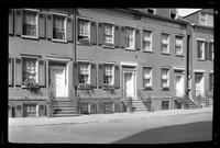 Manhattan / Brooklyn: [unidentified block of brick townhouses, undated.]