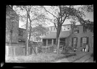 Manhattan / Brooklyn: [3/4 angle on the back yards of  unidentified small brick townhouse and adjacent old-Dutch-style house, undated.]