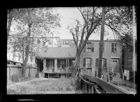 Manhattan / Brooklyn: [back yards of  unidentified small brick townhouse and adjacent old-Dutch-style house, undated.]