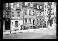 Manhattan / Brooklyn: [two smaller unidentified brick townhouses between two larger apartment buildings, undated.]
