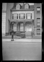 Manhattan / Brooklyn: [unidentified small wooden townhouse with wrought iron work on verandah, undated.]