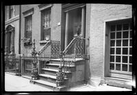 Manhattan / Brooklyn: [front door, wrought iron railing, and stoop of unidentified brick townhouse, undated.]