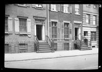 Manhattan / Brooklyn: [entrances to two unidentified townhouses, undated. 'To let / furnished apartment' sign on right hand building.]