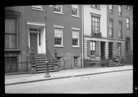 Manhattan / Brooklyn: [front doors and stops of several unidentified townhouses, undated.]