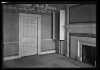 Flatlands: [interior view of Ryerson House living room with fireplace, interior door (closed) undated.]
