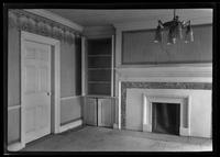 Flatlands: [interior view of Ryerson House living room with fireplace, interior door (closed), and light fixture, undated.]