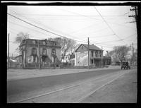 [Newtown: Samuel Renne House (left) (later Bretonaire House) on unidentified road with trolley tracks and lines overhead, Elmhurst, 1923.]