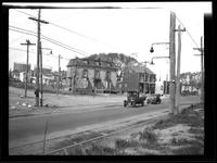 [Newtown: Samuel Renne House (left) (later Bretonaire House) on unidentified road with trolley tracks and lines overhead, Elmhurst, [1923].]