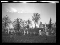 Newtown: [unidentified cemetery with stone church visible on hill in background, undated.]