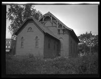 Newtown: [rear view of unidentified wood church, undated.]