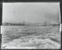 Manhattan: Lower Manhattan and the Brooklyn Bridge, viewed from a boat to the south, 1890s.