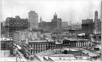 Manhattan: rooftop view of Lower Manhattan, undated. Youle Shot Tower at right; Pulitzer dome (New York World Building), center; Fulton Street in foreground.