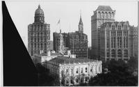 Manhattan: 'Newspaper Row' on Park Row, looking southeast from Broadway, undated. The New York World Building, the New York Tribune Building, and the New York Times Building visible; City Hall partly visible in foreground.