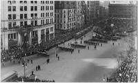 Manhattan: high-angle view of the Hudson-Fulton parade at the intersection of Fifth Avenue and Broadway between 23rd Street and 25th Street, 1909.