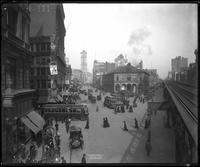 Manhattan: Herald Square, 1909. Elevated train line visible.