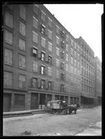 111 W. 51st Street, New York City, undated. Horse-drawn cart in front.