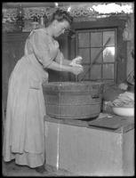 Ethel Gray Magaw Hassler washing clothes in a tub, ca. 1912.