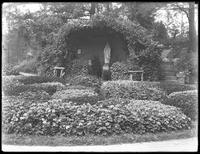 Flower garden and grotto of the Virgin Mary, Roman Catholic Orphan Asylum, ca. 1912.