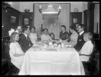 Hassler friends and relatives at dinner in 150 Vermilyea Avenue, Apartment 44, New York City: Mr. and Mrs. Lee, Gray, Hedda, William Gray Hassler, Harriet E. Hassler, Ethel Gray Magaw Hassler and Reddy (cat), undated.