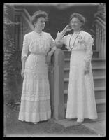 Eva [Emma?] Hassler and Eleanor B. Hassler posed at the front steps of a large house, undated (ca. 1913).