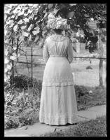 Full-length rear view of Julia Hassler, showing details of her dress and hat, undated (ca. 1913).