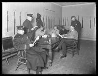 Officers relaxing in an unidentified police station lounge, undated (ca. 1913-1914).