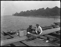 Italian crabbers on a dock just around the point from New York Harbor, Bay Ridge, Brooklyn, undated. Photographed for Joseph P. Day.