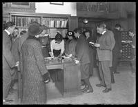 Patrons at the reference desk of the Brownsville branch of the Brooklyn Public Library, November 16, 1914.