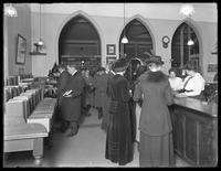 Patrons in the charging [check-out?] room of the Montague branch of the Brooklyn Public Library, November 17, 1914.