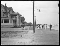View along the boardwalk from Beach 125th Street, Belle Harbor, Queens, July 11, 1915. Photographed for Joseph P. Day.
