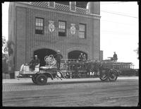 Hook & ladder truck in front of the Far Rockaway fire station showing engines, fire fighters, Belle Harbor, Queens, July 12, 1915.  Photographed for Joseph P. Day.