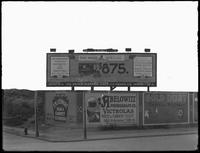 Billboards on an unidentified street corner, including one for the United Electric Light & Power Company, New York City, undated [ca. September 1915]. Background partially matted out.