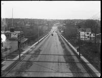 View looking west from the el station at 233rd Street and White Plains Road, Bronx, April 28, 1916. Photographed for Joseph P. Day.