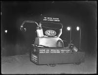 Night shot of a United Electric Light & Power Company promotional vehicle featuring a giant electric iron, New York City, undated [ca, June / July 1916].