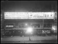 Night view of United Electric Light & Power Company billboards at W. 145th Street in Washington Heights, New York City, July 24, 1916.