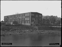 Completed sail loft building for Ratsey & Lapthorne, City Island, Bronx, January 6, 1917. Photographed for G.E. Tilt & Company. View from the dock.
