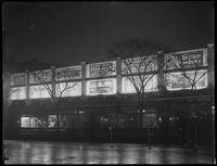 Floodlit billboards on Broadway between W. 92nd and 93rd Streets, New York City, January 8, 1917. Photographed for the United Electric Light & Power Company.