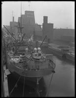 Brooklyn docks with ship and grain elevators, undated (ca. June 1917).